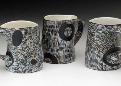 Sgraffito black and white mugs