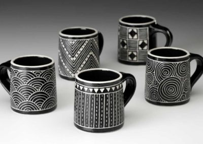 Small black and white mugs